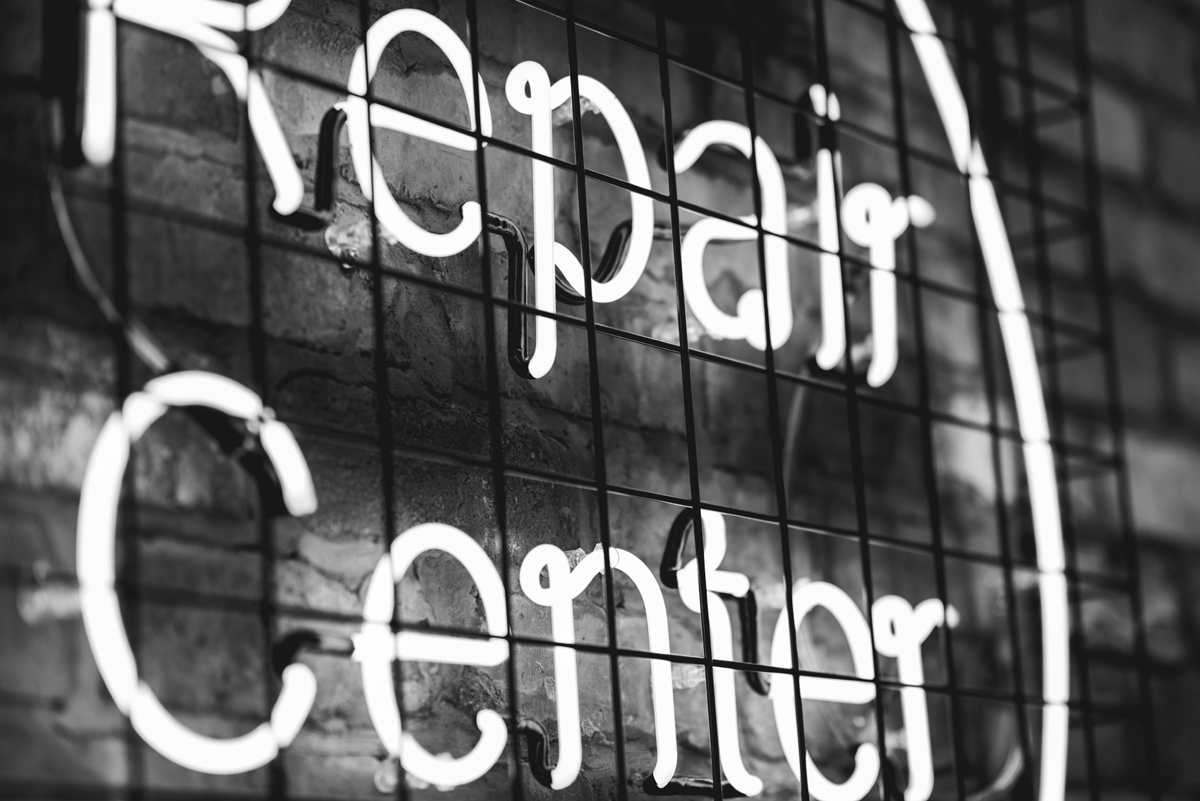 Neon Repair Center Sign Photo by Dana Vollenweider on Unsplash